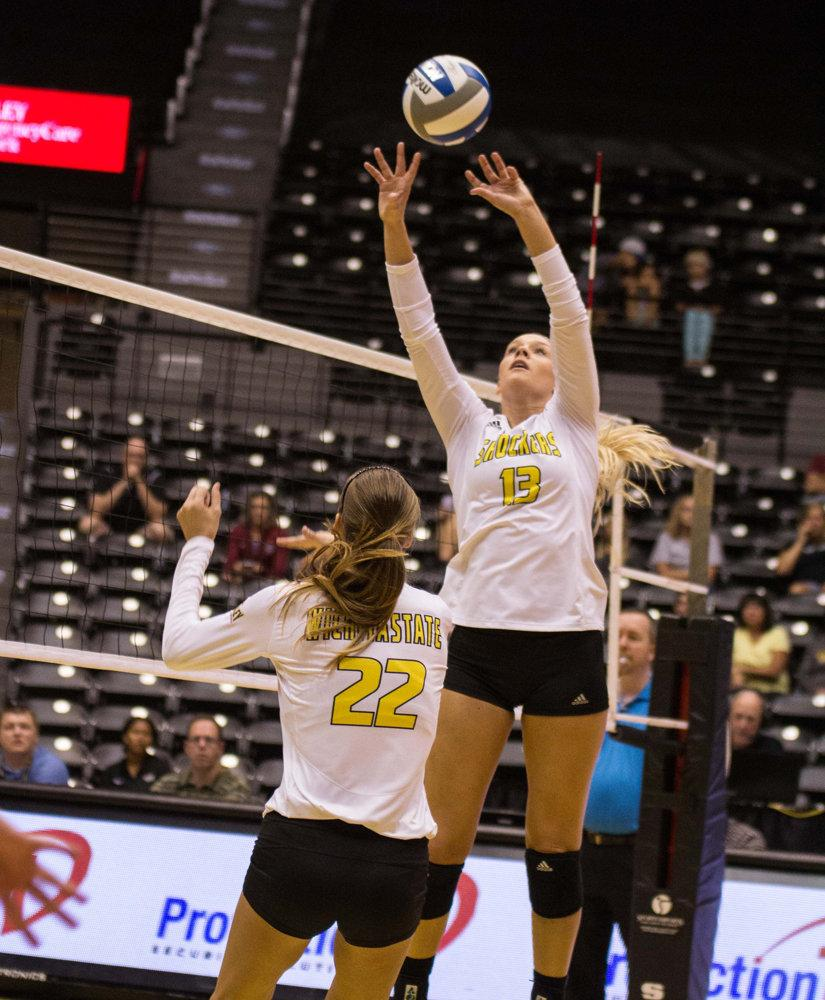 Junior Emily Hiebert sets up the ball for junior Abbie Lehman in a game against IUPUI at Charles Koch Arena. Hiebert was the first WSU player to win Setter of the Year on Thursday.
