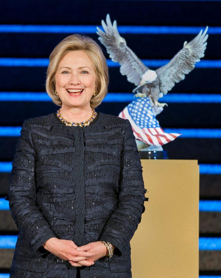 Former+Secretary+of+State+Hillary+Rodham+Clinton+receives+the+National+Defense+Foundation+University%27s++%28NDU%29+American+Patriot+Award+during+a+gala+dinner+at+the+Ronald+Reagan+Center+in+Washington%2C+Thursday%2C+Nov.+14%2C+2013.+The+American+Patriot+Award+annually+recognizes+leaders+of+extraordinary+caliber+who+have+strengthened+America%E2%80%99s+strategic+interests+and+advanced+global+security.+++