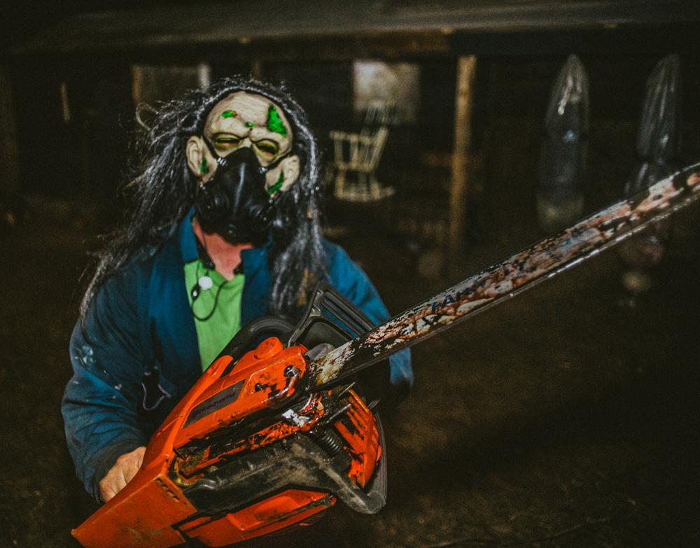 An actor with a chainsaw poses for a picture at the Wicked Island at OJ Watson Park. The Wicked Island is located at 3022 S. Mclean Blvd.