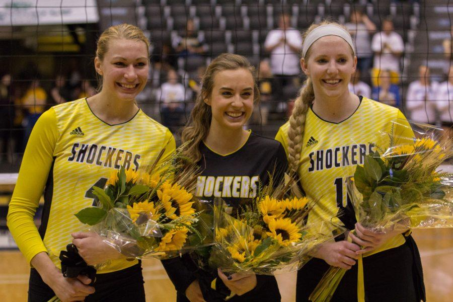 Wichita+State+seniors+Katy+Dudzinski+%284%29%2C+Dani+Mostrom+%286%29%2C+and+Jody+Larson+%2811%29+pose+together+before+their+final+home+game+of+their+college+careers.+The+girls+were+given+flowers+during+a+ceremony+Saturday+night+honoring+the+outgoing+seniors.