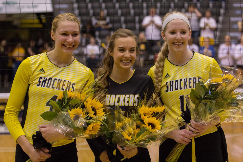 Wichita State seniors Katy Dudzinski (4), Dani Mostrom (6), and Jody Larson (11) pose together before their final home game of their college careers. The girls were given flowers during a ceremony Saturday night honoring the outgoing seniors.
