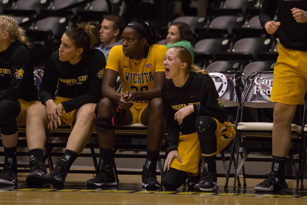 Wichita State guard Hannah Mortimer (2) cheers on her team during Wednesday night's exhibition against Newman.