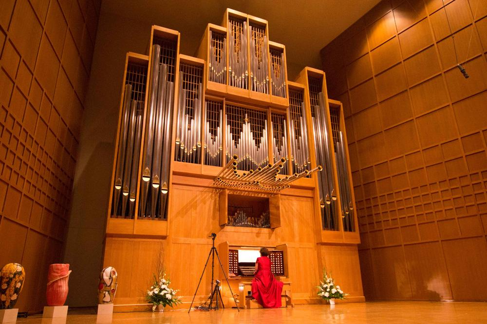 Organist Lynne Davis preforms Tuesday night as part of the 30th anniversary ceremony of Weidemann Hall.