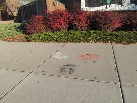 University responds to sidewalk chalk drawings, racial slurs