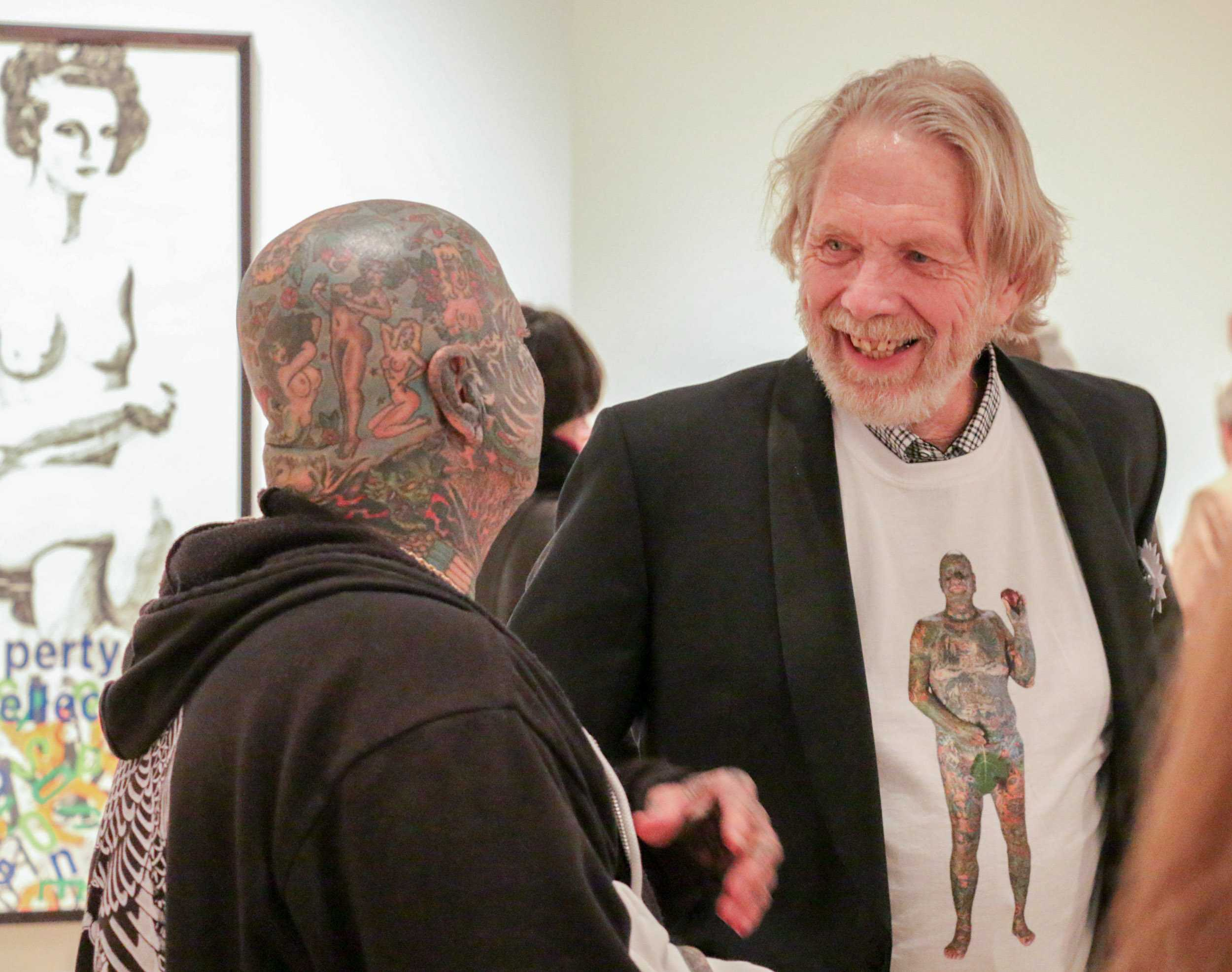 Professor Larry Schwarm talks to his subject Larry K. during opening night at the Ulrich Museum of Art on Saturday.