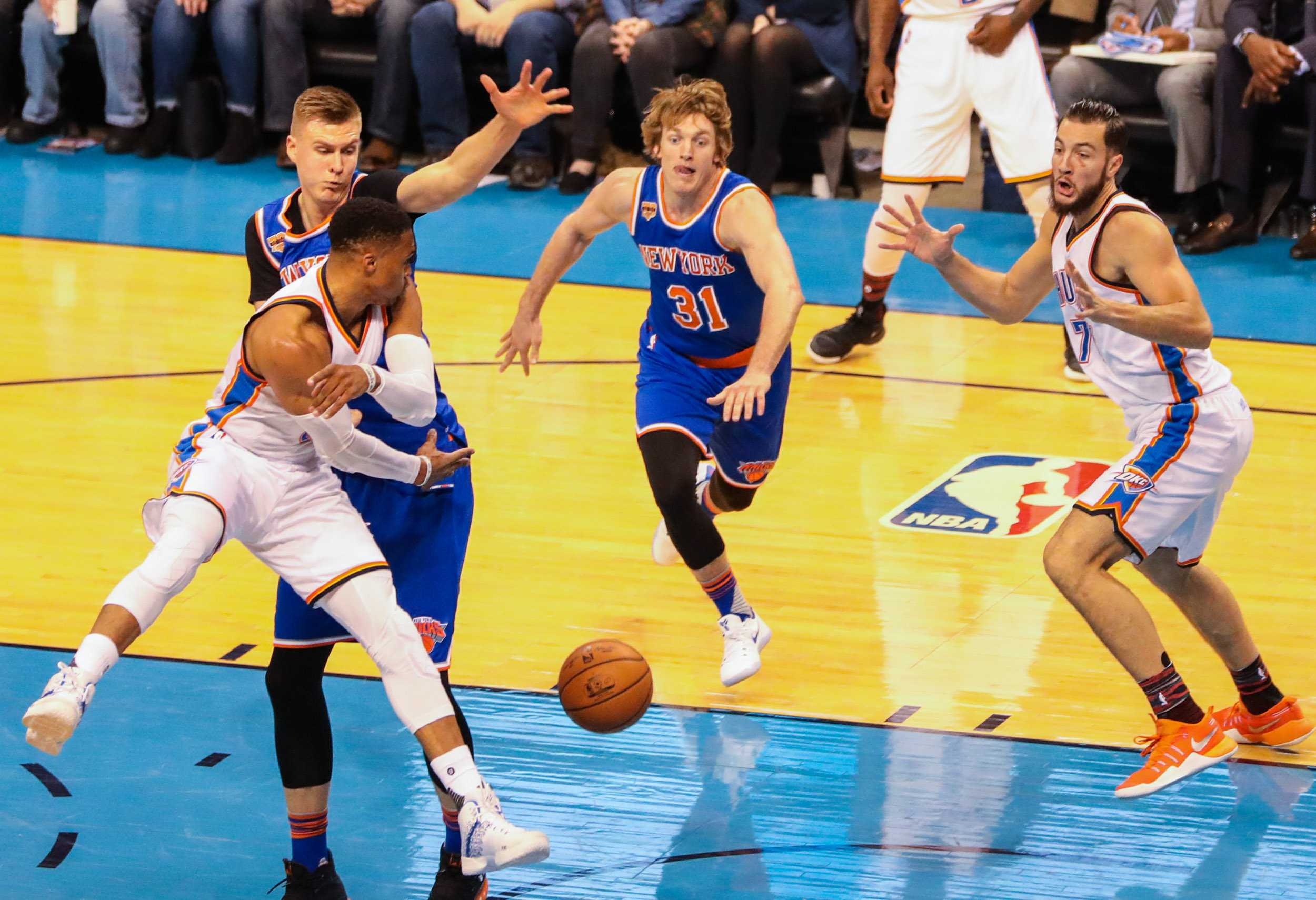Former Wichita State Shocker Ron Baker, center, lunges for a ball, when the New York Knicks played the Oklahoma City Thunder in Chesapeake Energy Arena. Baker played a total of 18 minutes. (Feb. 15, 2017)