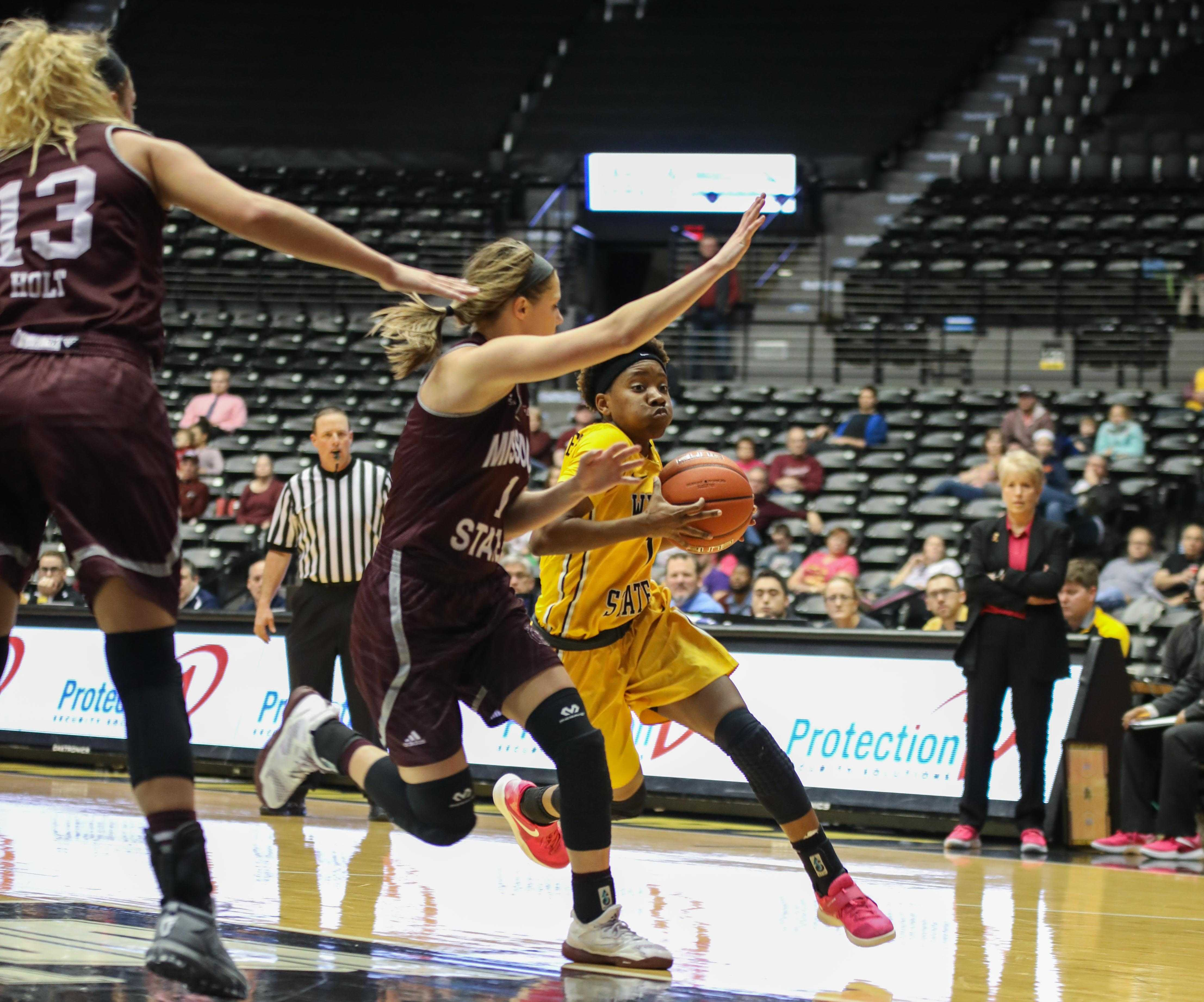 Keke Thompson drives into the lane Sunday afternoon against Missouri State. Wichita State lost 60-65.