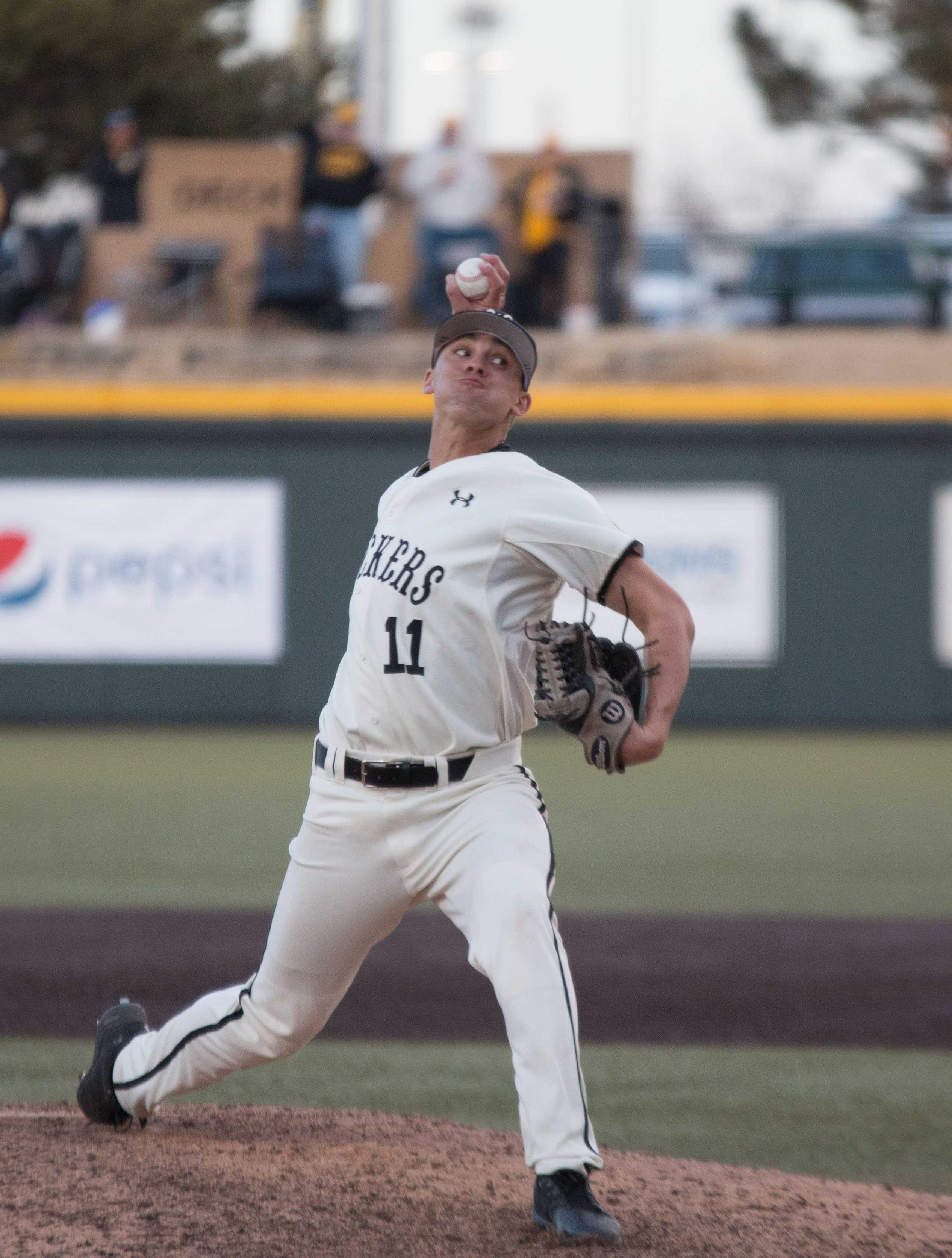Wichita State's Ben Hecht winds up for a pitch during the game against Utah Valley. Hecht pitched during one inning of the game. (Feb. 17, 2017)