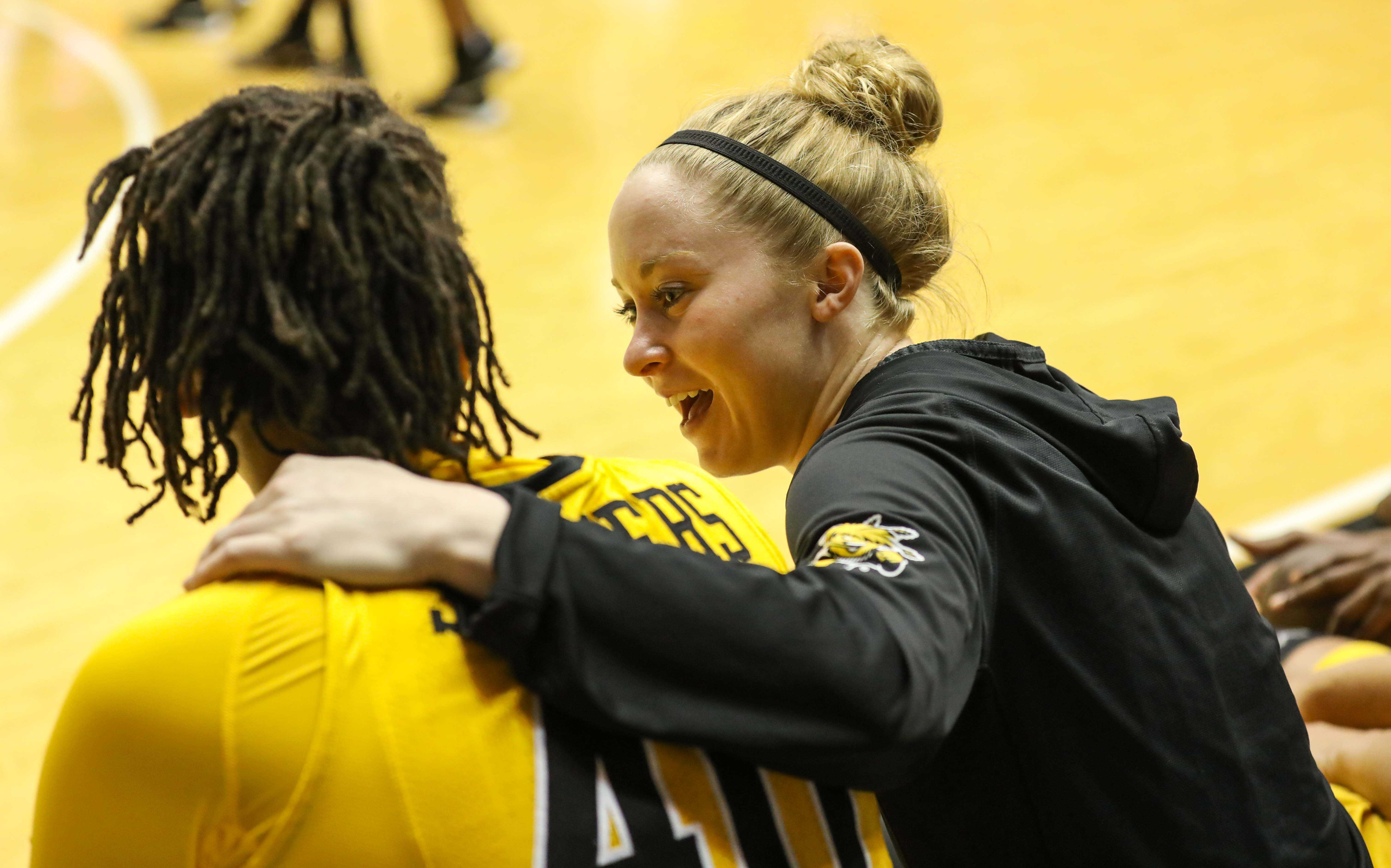 Wichita State senior Hannah Mortimer (2) puts her hand around Angiee Tompkins (40) in the second half of Sunday's game. (Feb. 26, 2017)