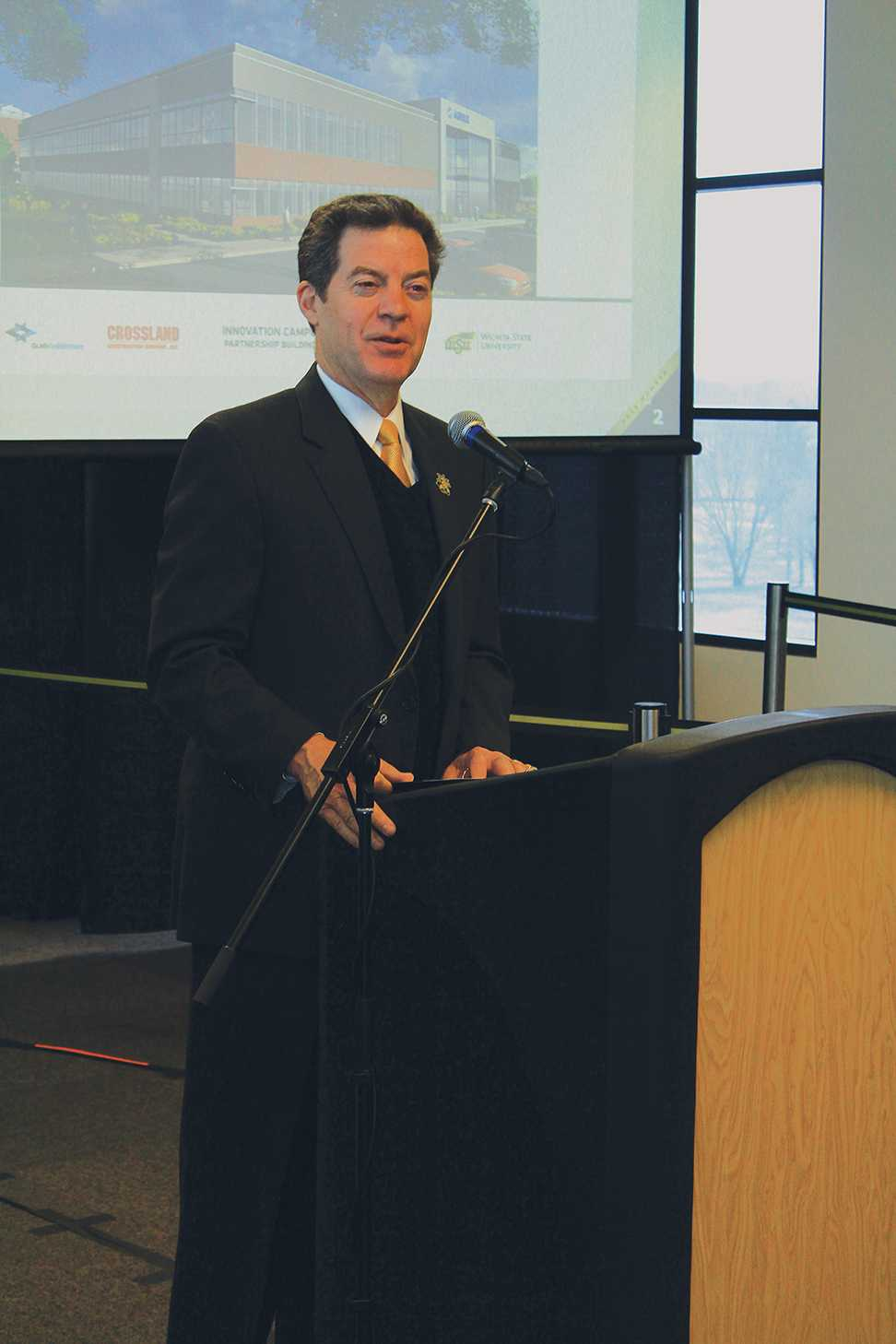 Gov. Sam Brownback speaks at Wichita State in 2015.