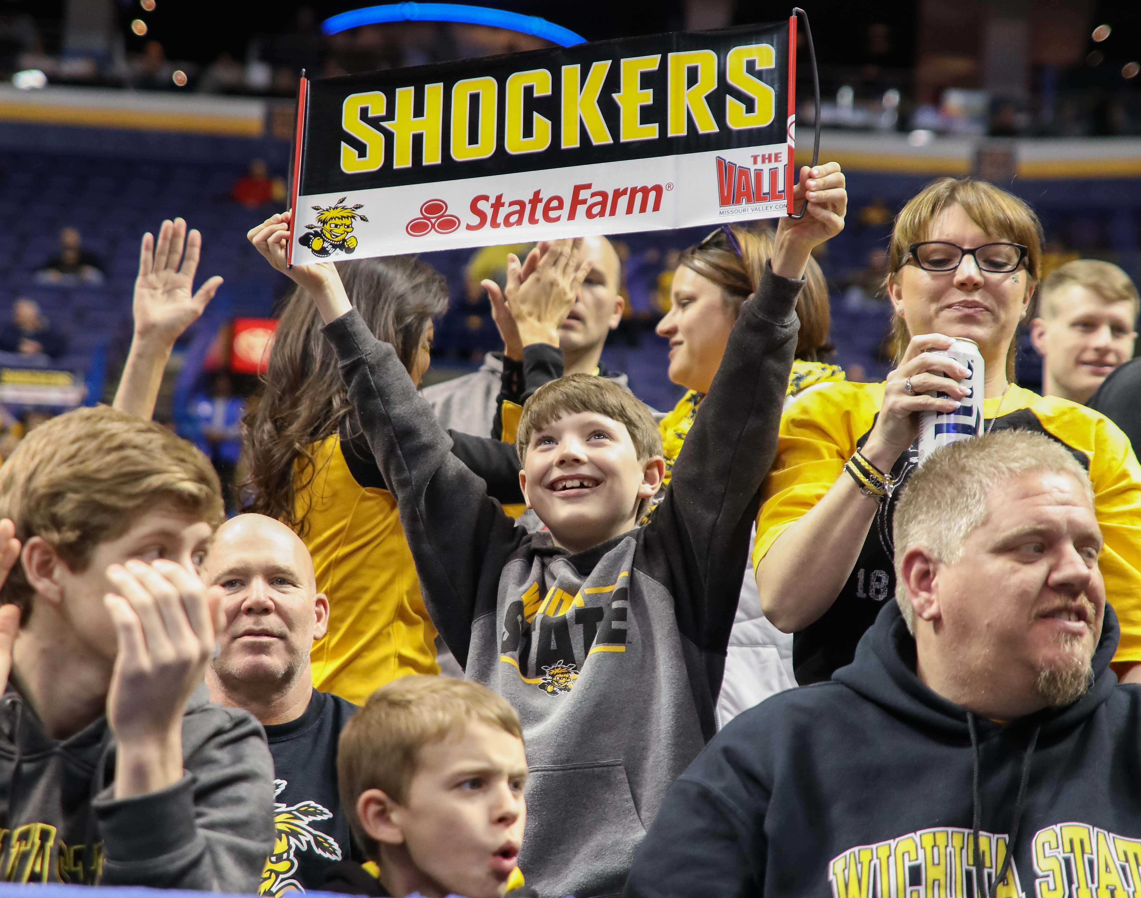 A young Wichita State fan celebrates WSU's 82-56 win over Bradley.