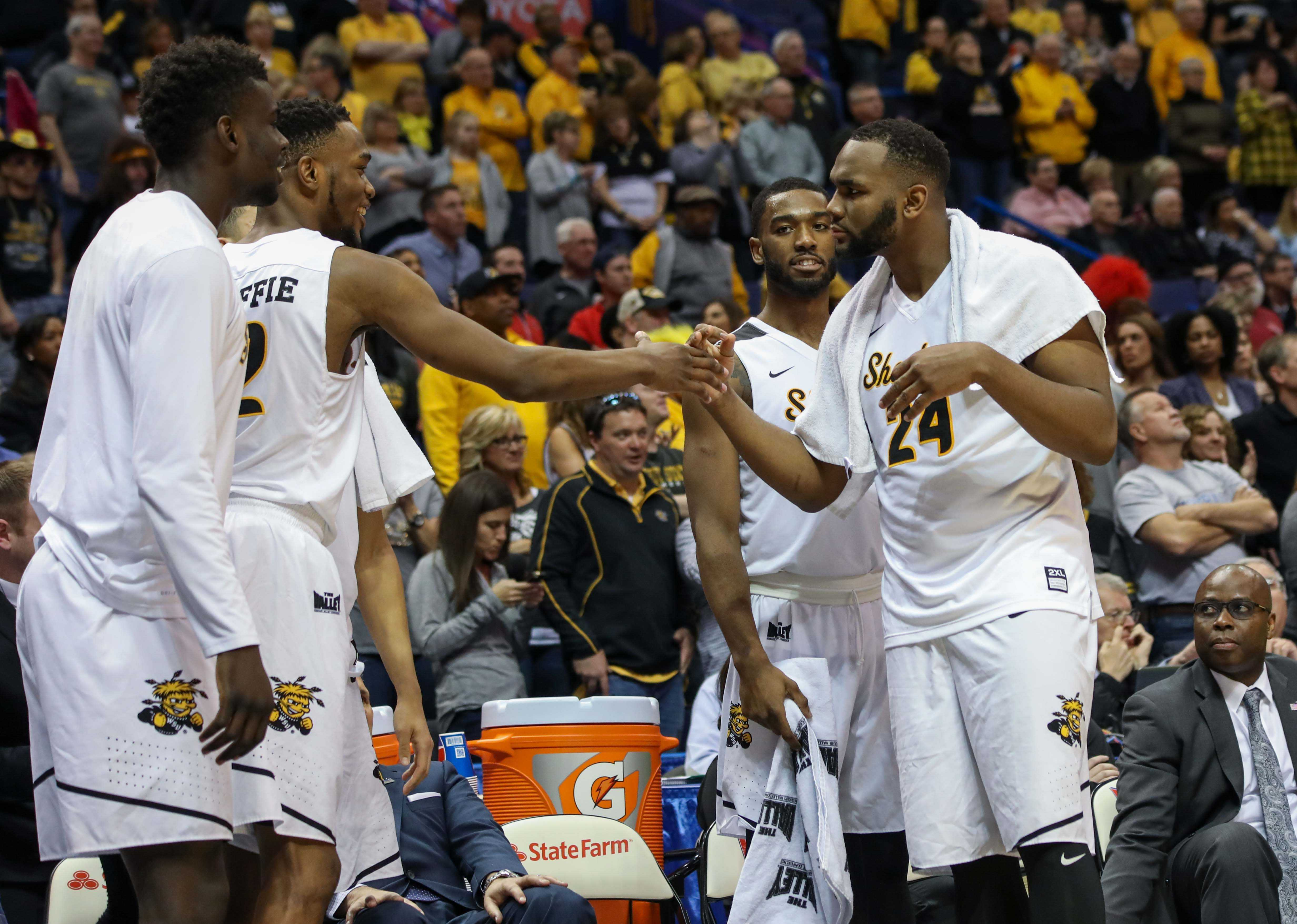 Wichita State's Markis McDuffie (32) and Shaquille Morris (24) celebrate the Shocker win.