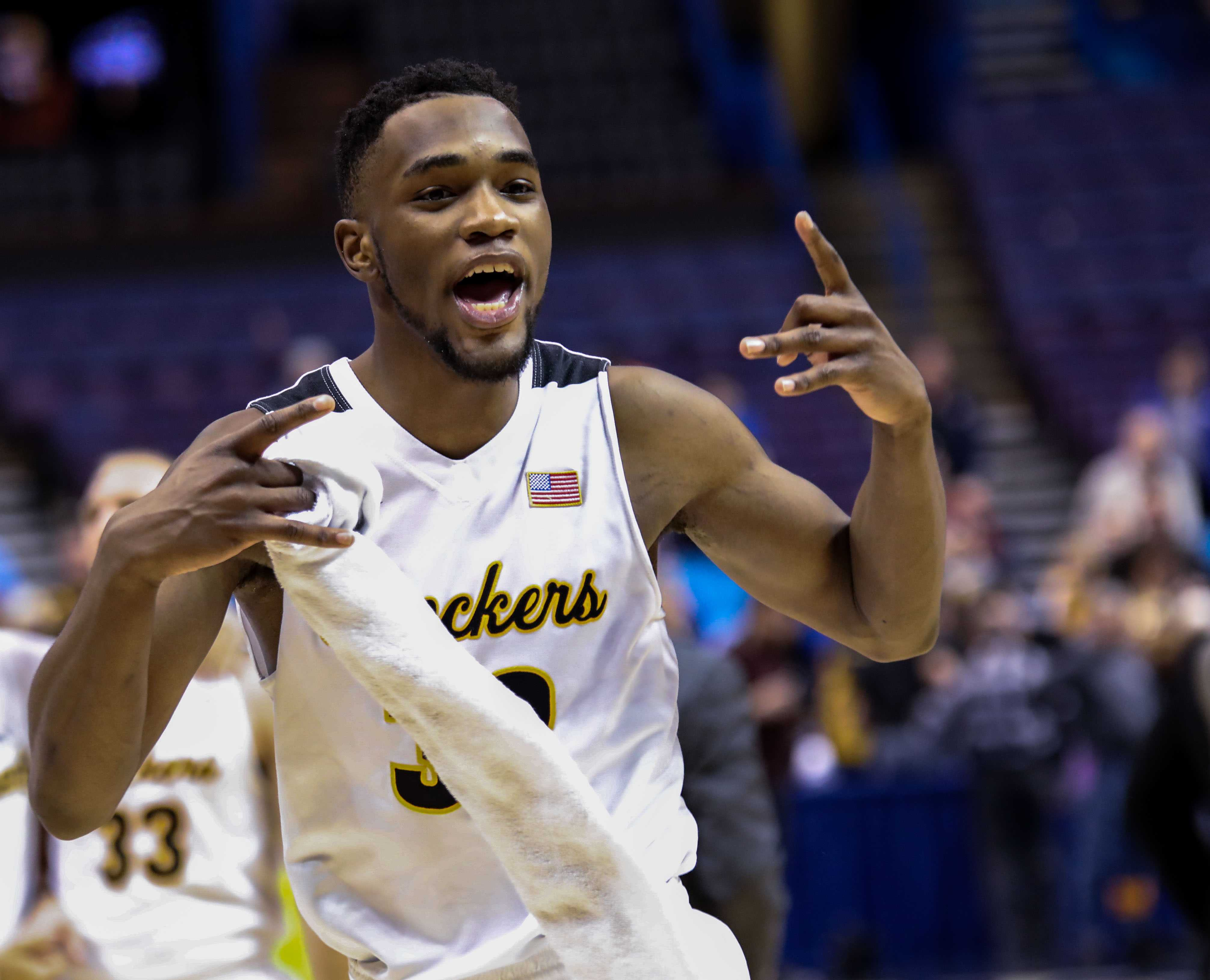 Wichita State's Markis McDuffie (32) celebrates the Shockers' victory.