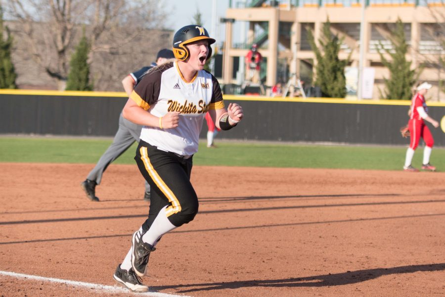 Senior+Macklin+Hitz+cheers+as+she++runs+to+home+base+after+hitting+a+homerun+against+Nebraska.+