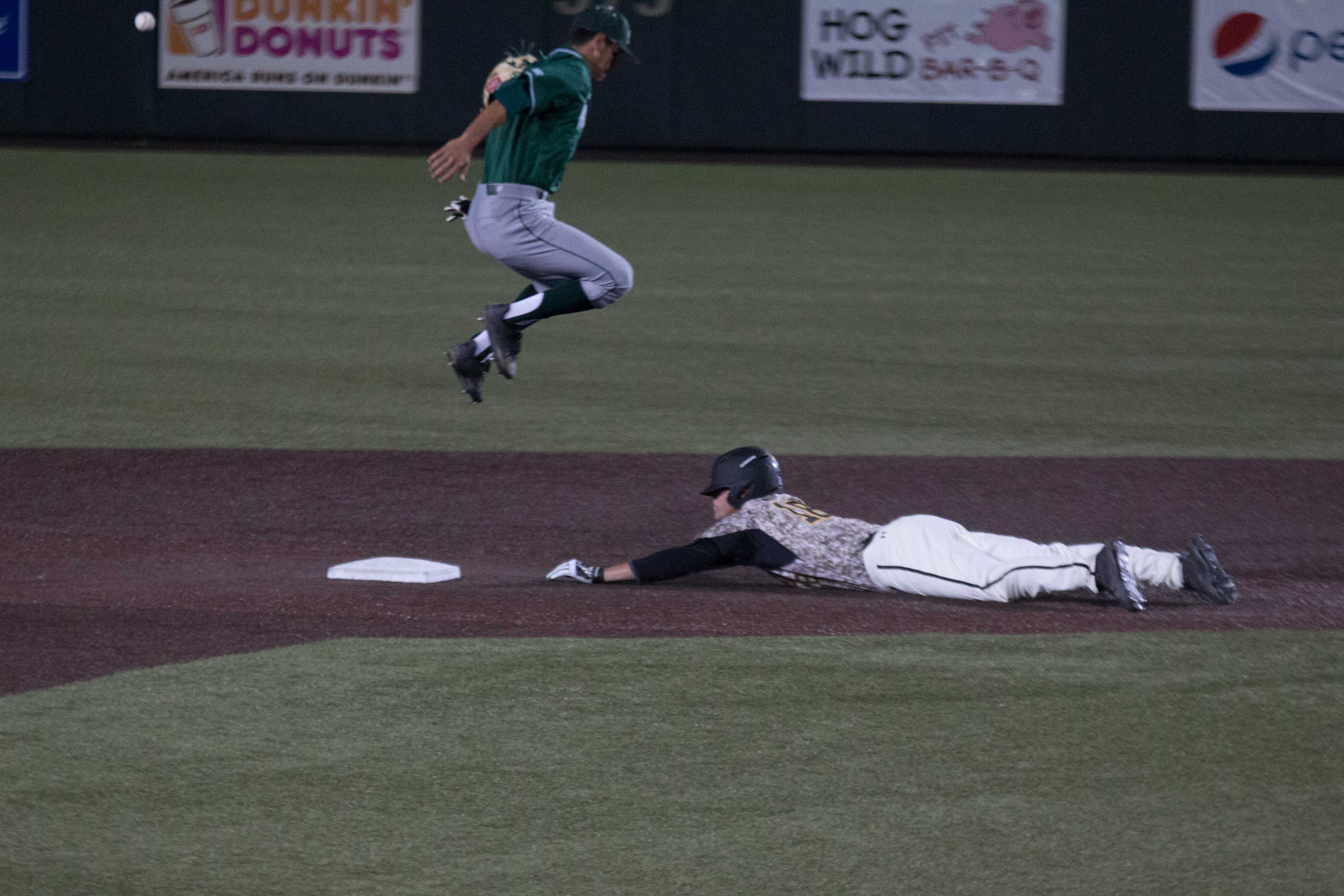 Sophomore Alec Bohm steals second base during the game against Sacramento.