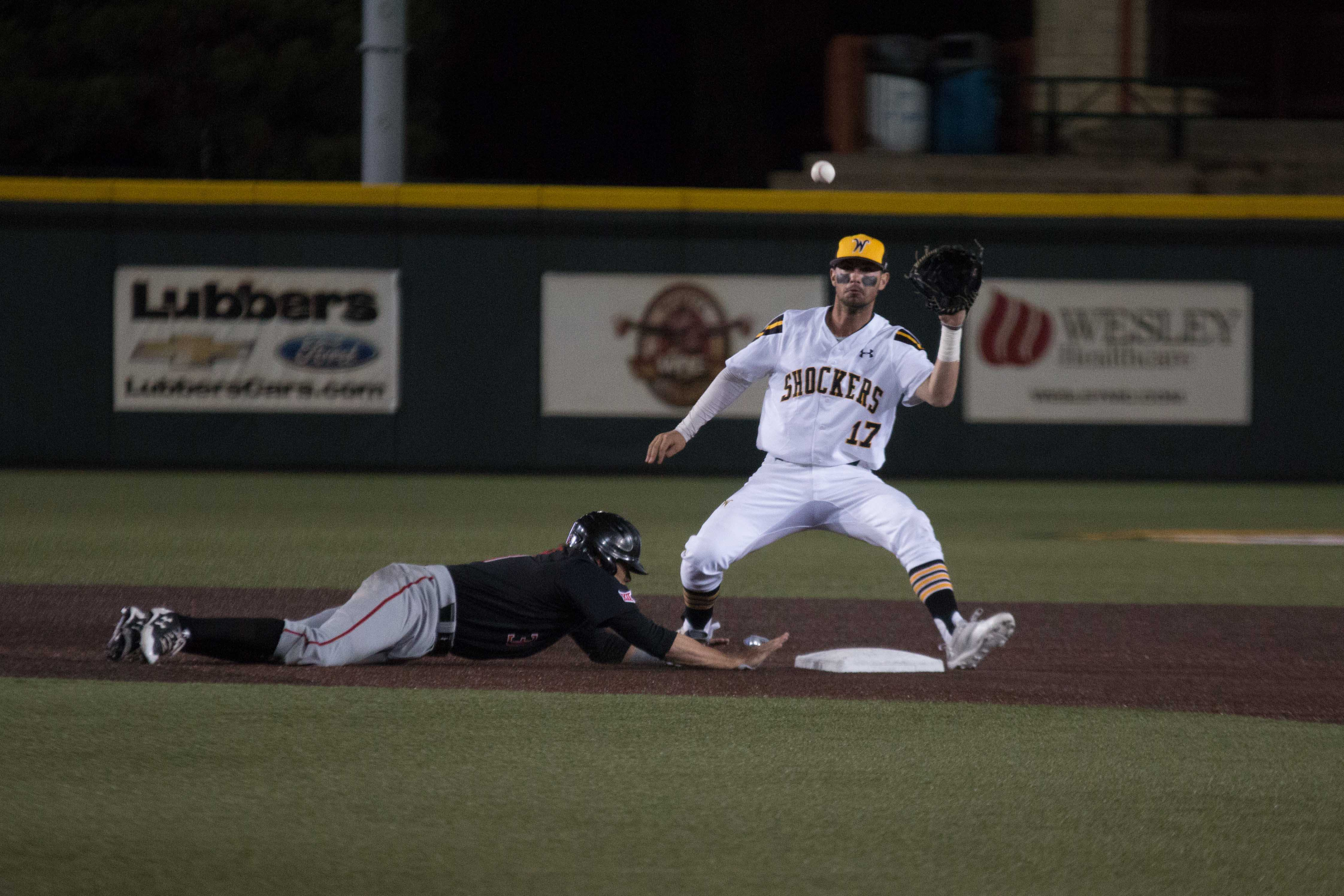 Junior Trey Vickers tags the base to get a Texas Tech player out.