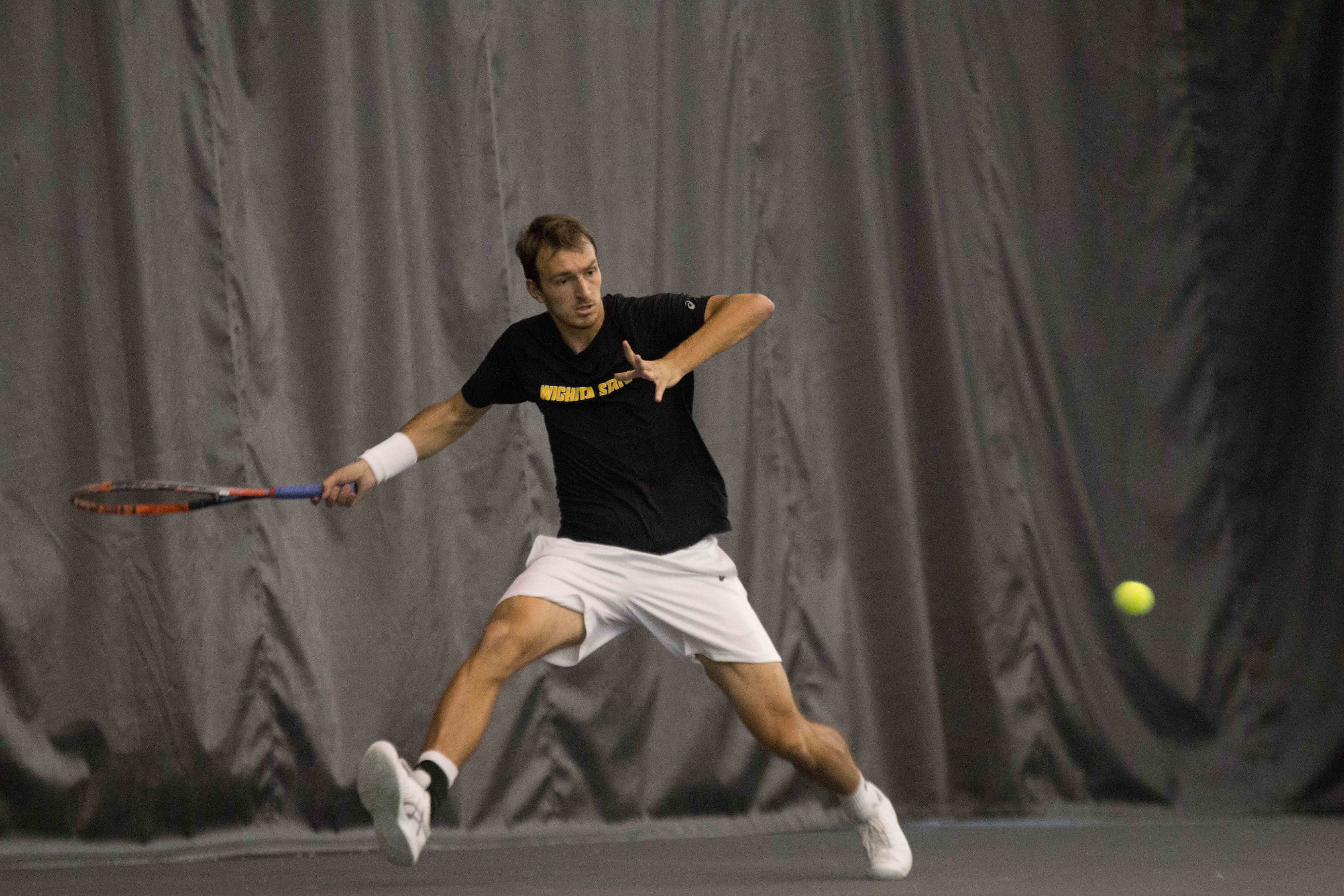 Junior Miroslav Herzan chases the ball to keep it from going out of bounds. Wichita State lost the match to Cornell.