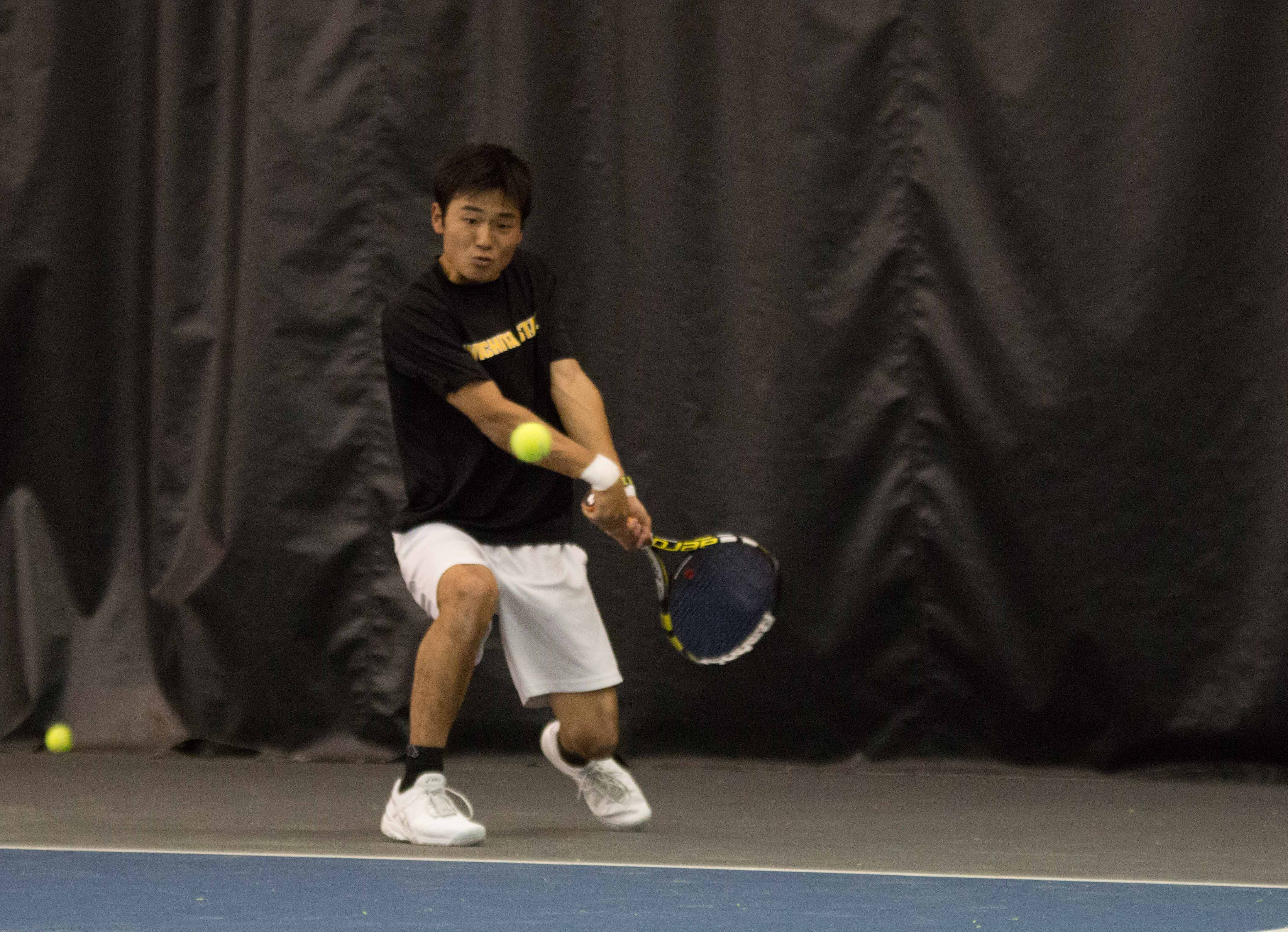 Sophomore Haru Inoue volleys the ball back to a Cornell player on March 11. Wichita State lost their match against MVC-foe Drake on Saturday afternoon.