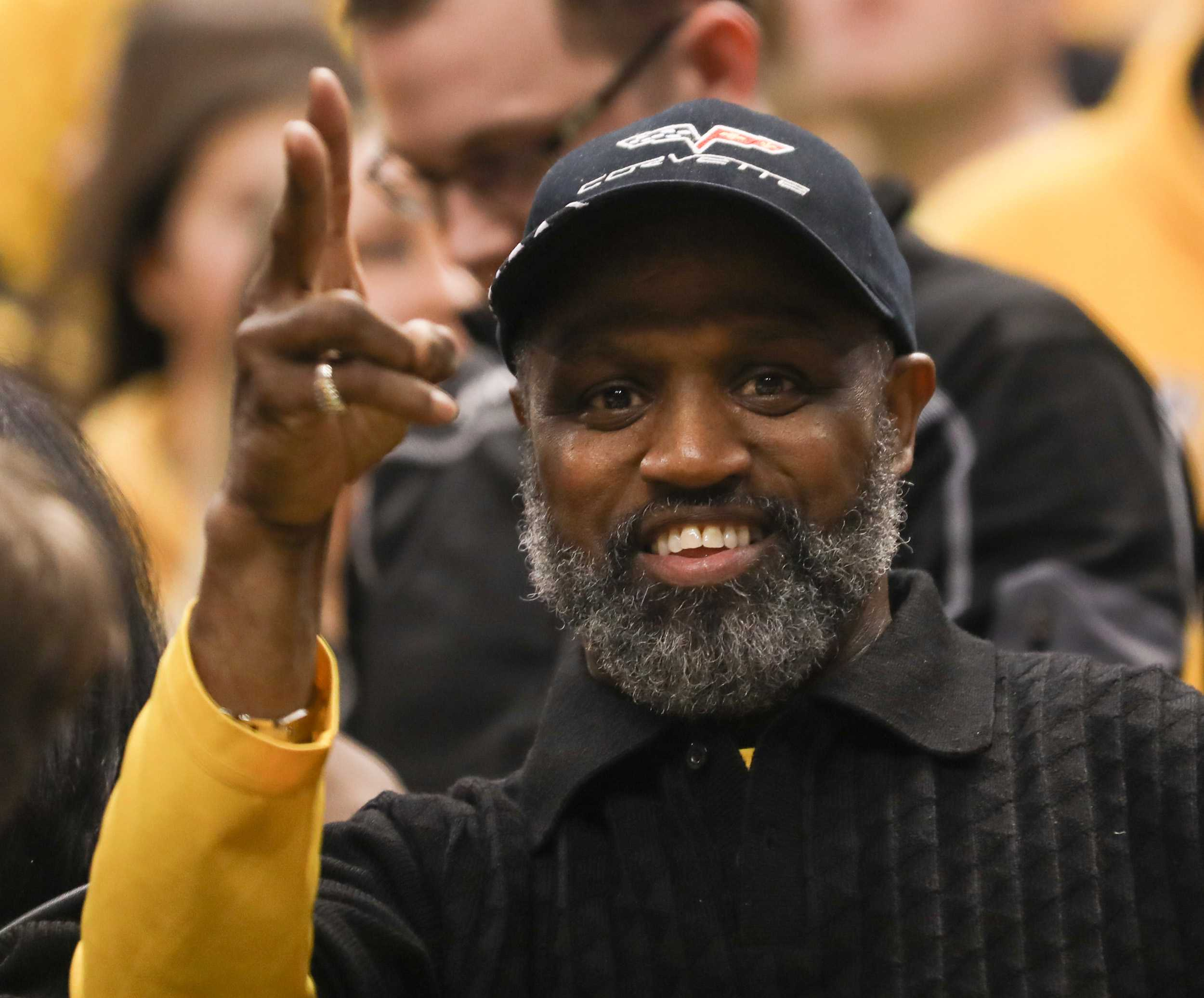 Elton Wooten cheers on the Shockers during their victory over the Dayton Flyers. (Mar. 17, 2017)