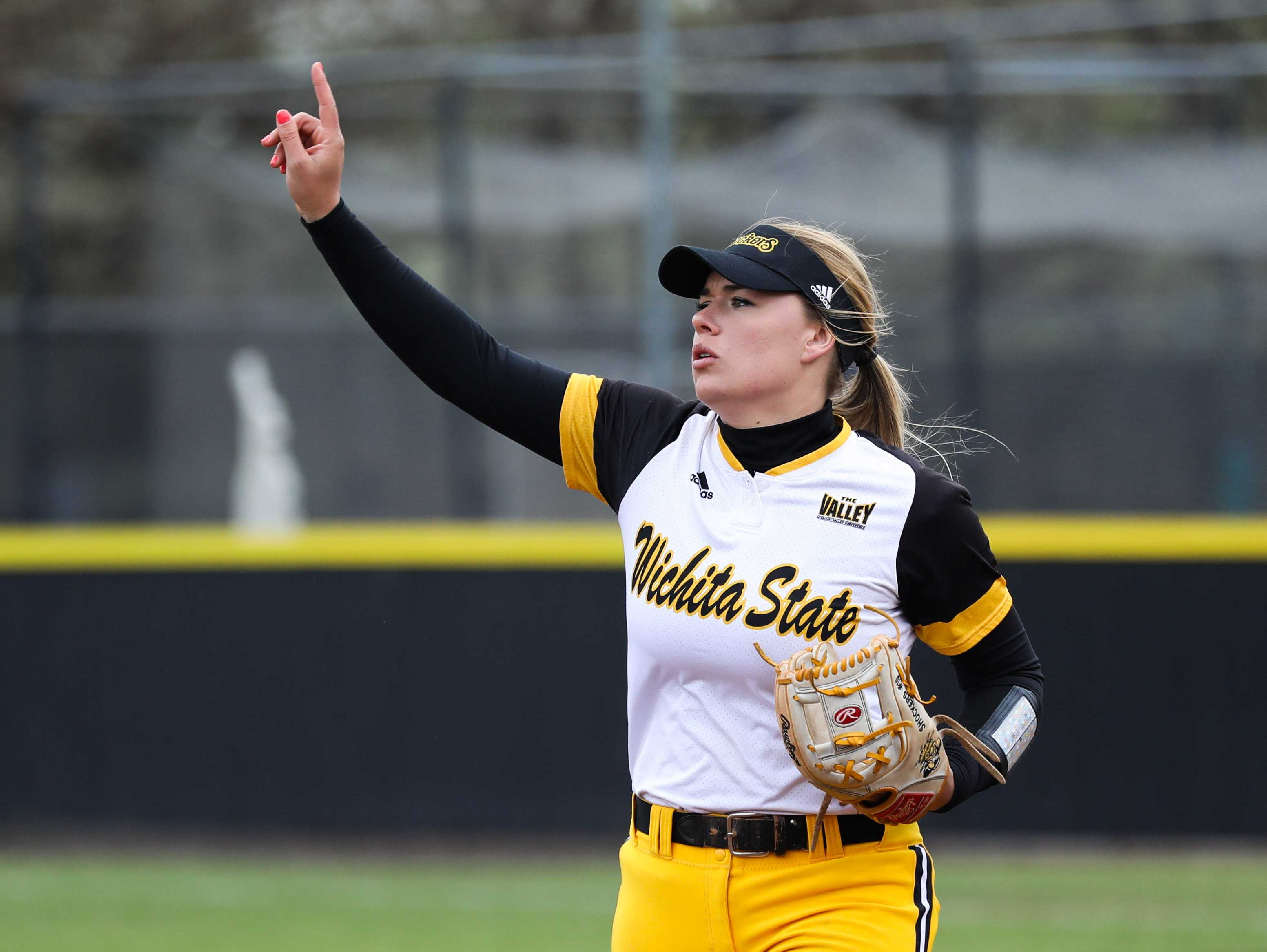Wichita State junior Mackenzie Wright (10) gestures to the team during their Saturday afternoon matchup with Illinois State. (Mar. 25, 2017)