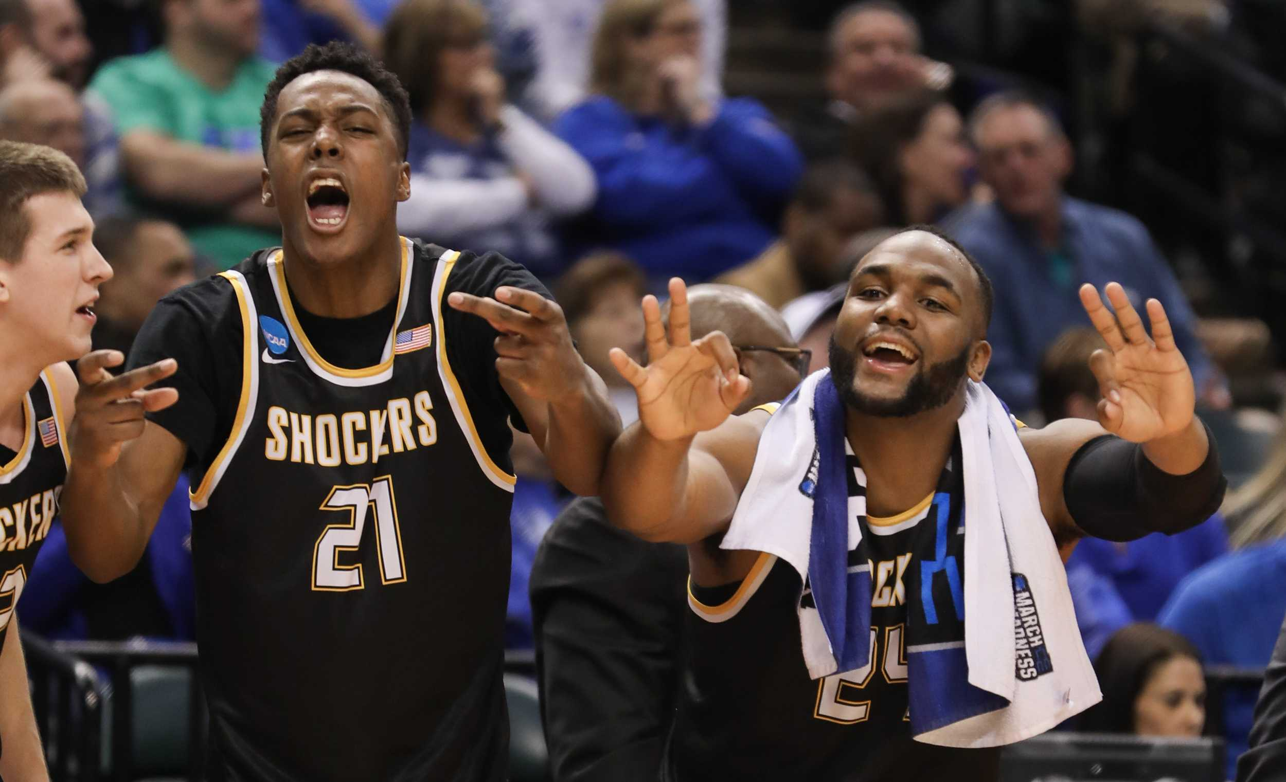 Wichita State's Darral Willis (21) and Shaquille Morris (24) celebrate a teammate's three-point bucket against Dayton in the second half at Bankers Life Fieldhouse in Indianapolis. (Mar. 17, 2017)