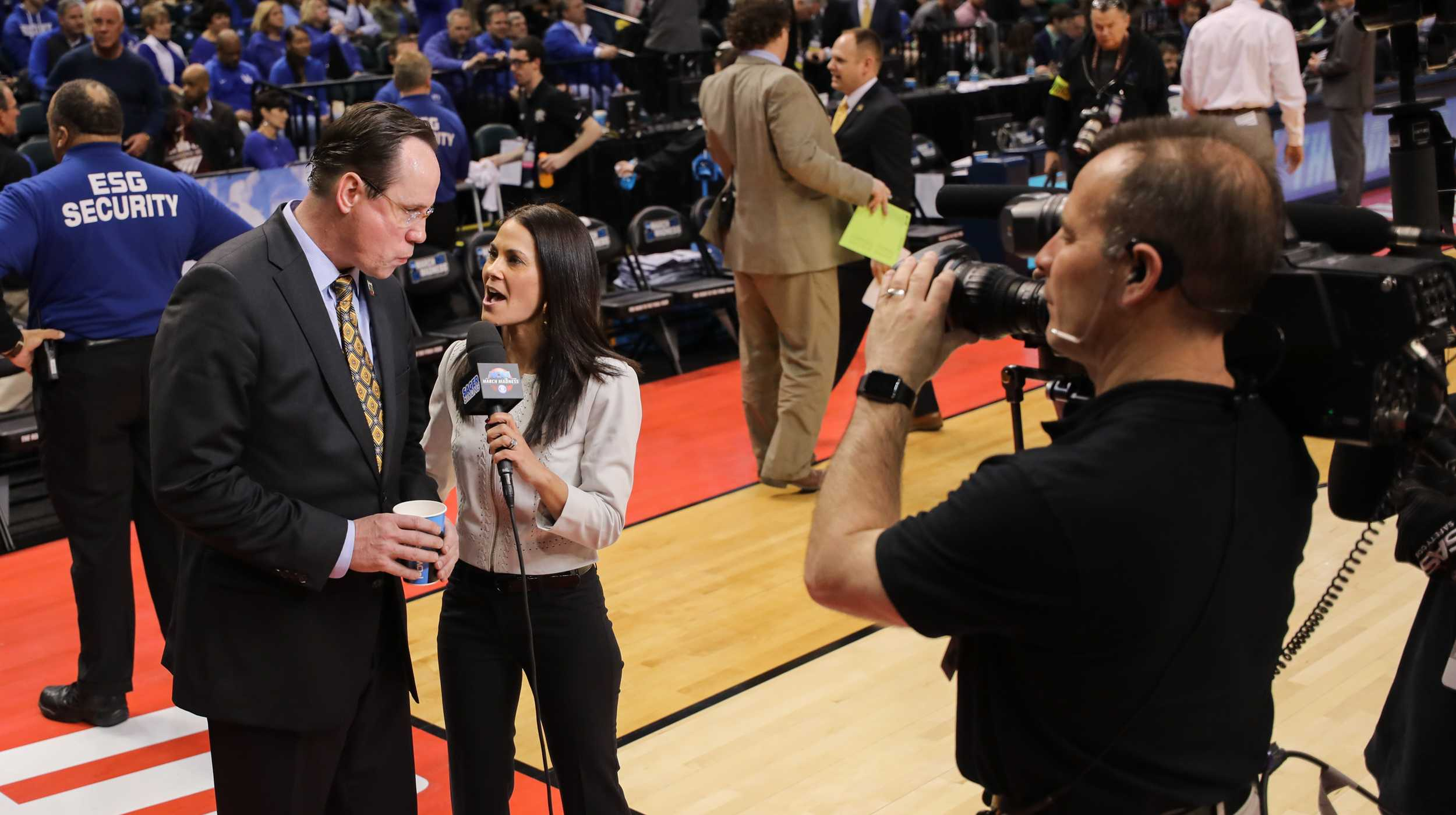 Wichita State head coach Gregg Marshall talks to CBS news anchor after the Shockers' 64 – 58 victory over the Dayton Flyer at Bankers Life Fieldhouse in Indianapolis