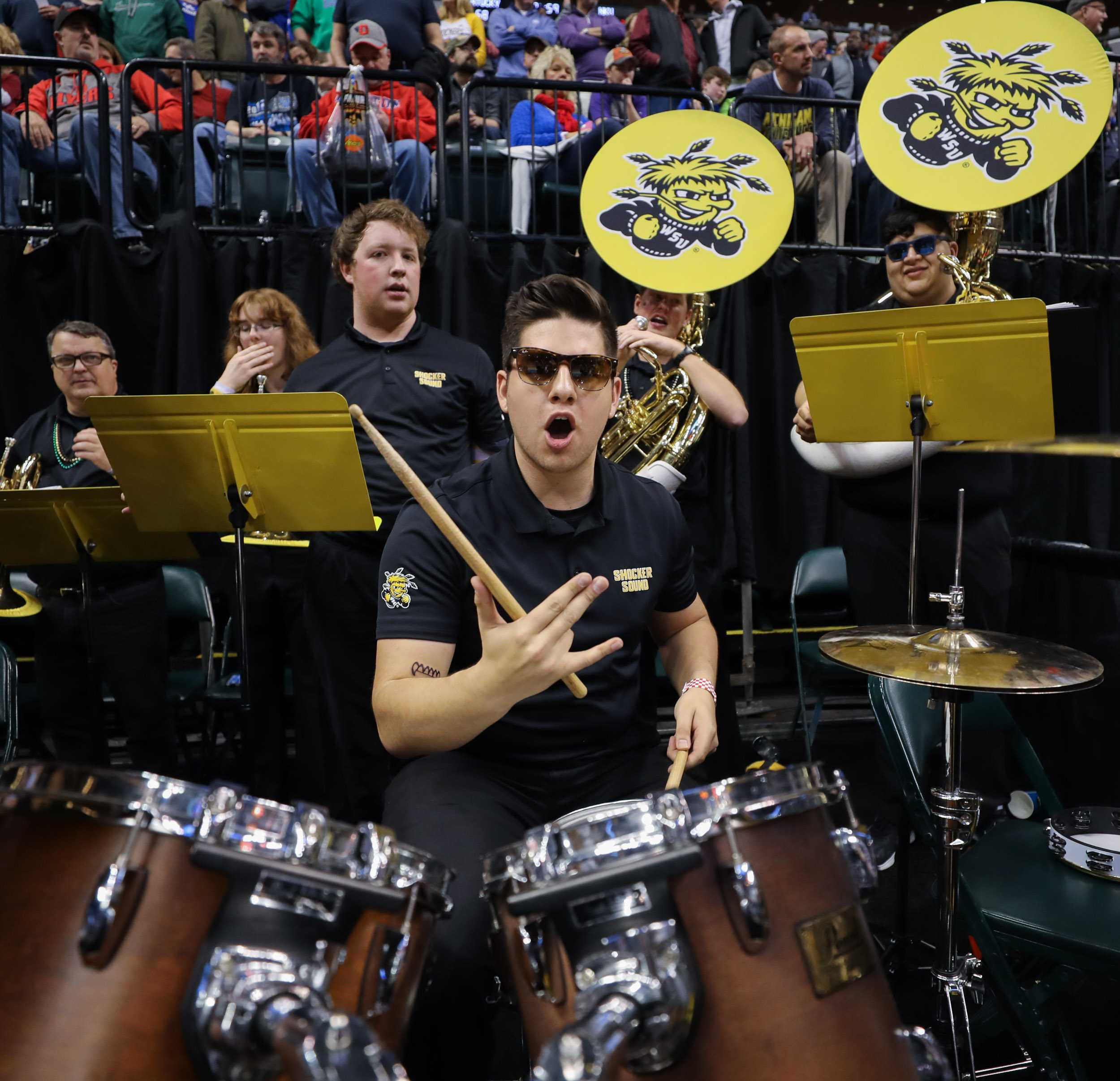 A member of the Wichita State band celebrates the Shockers' 64 – 58 victory over the Dayton Flyer  at Bankers Life Fieldhouse in Indianapolis. (Mar. 17, 2017)