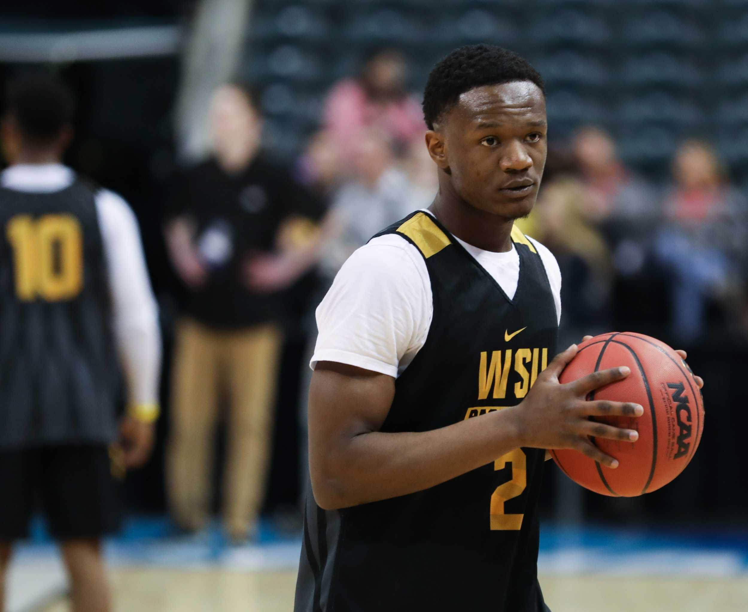 Wichita State's Daishon Smith warms up during the open practice in Bankers Life Fieldhouse in Indianapolis. The Shockers play Dayton in the first round of the NCAA Tournament. (Mar. 16, 2017)