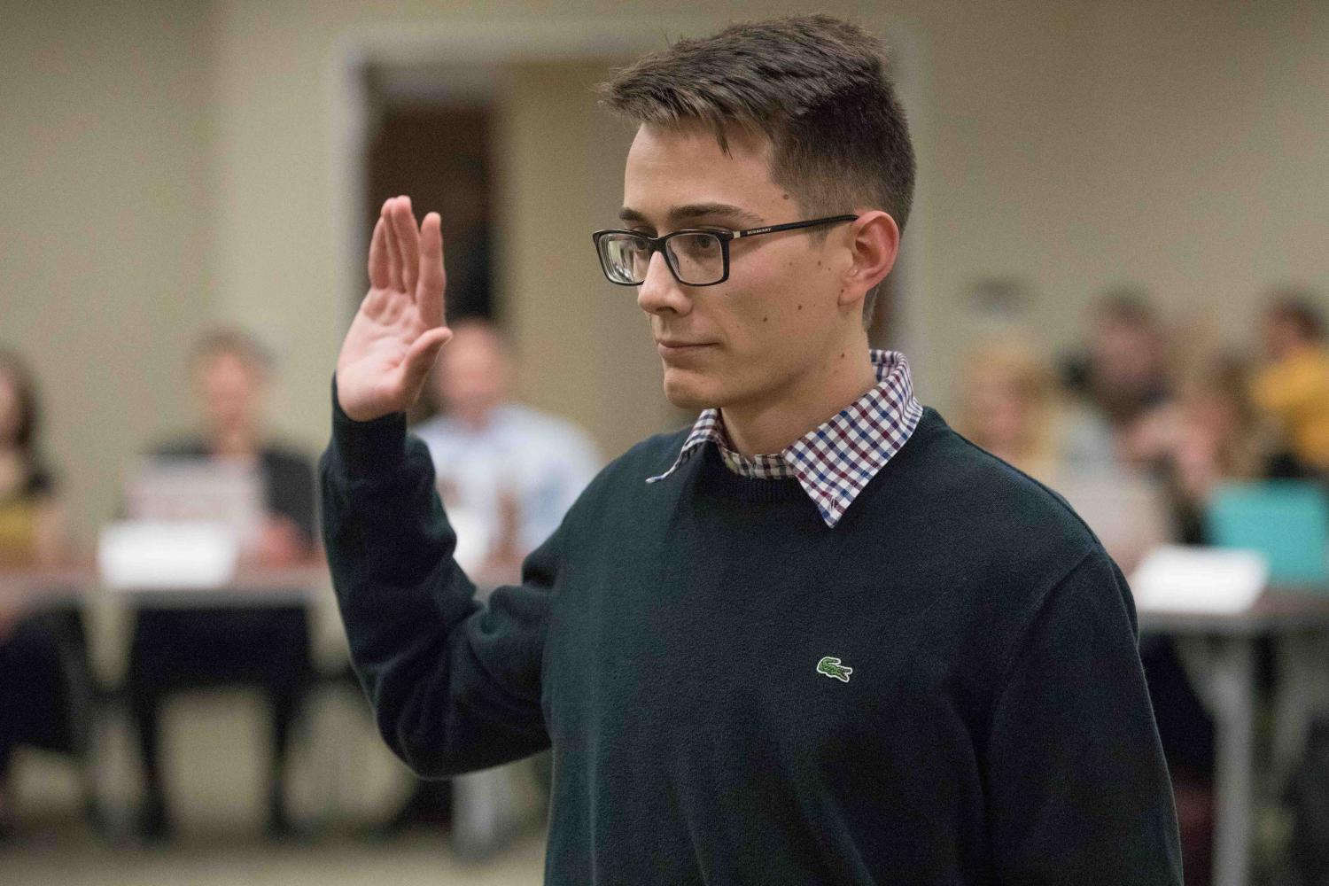 Andrew+Linnabary%2C+former+managing+editor+for+The+Sunflower%2C+is+sworn+in+as+SGA%27s+Director+of+Public+Relations.+Linnabary+will+serve+as+DPR+for+the+60th+Session+of+Wichita+State%27s+Student+Government+Association.+