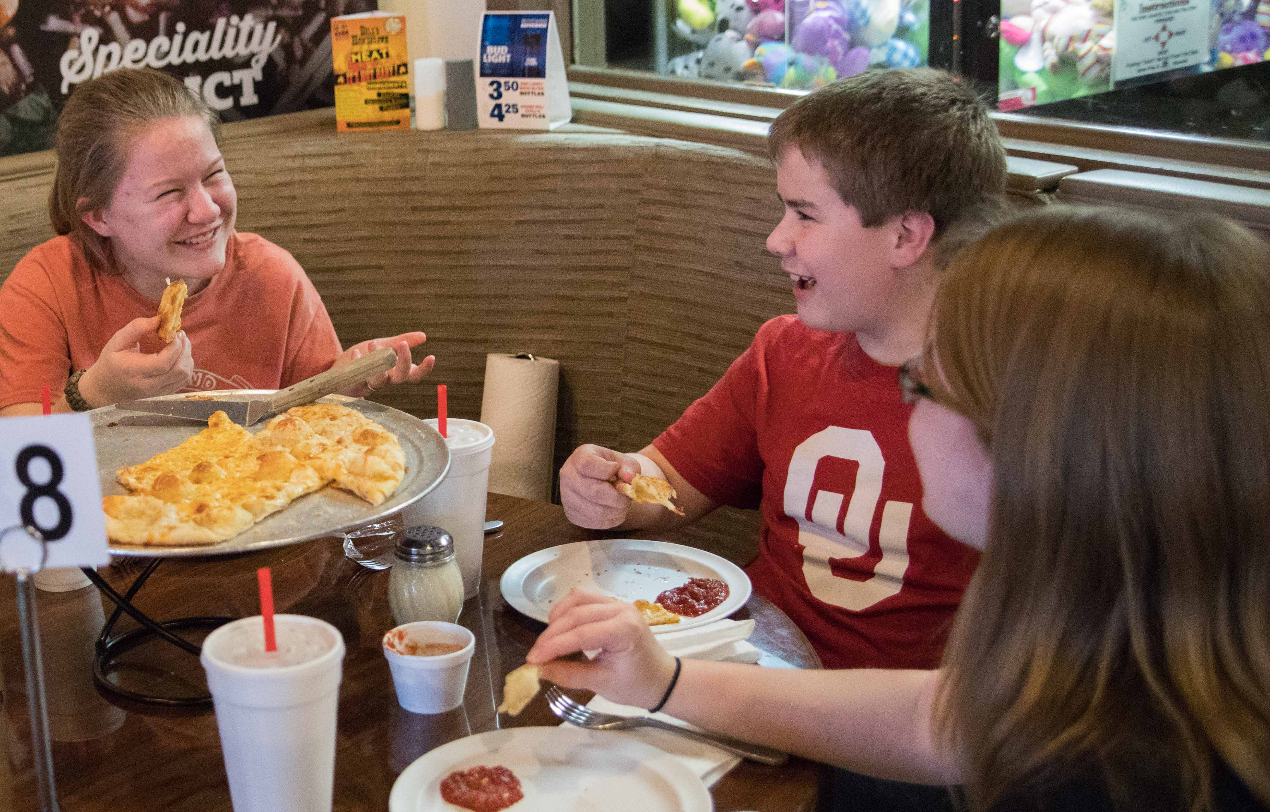 Lauren, Luke and Lindsay O'Neal (left to right) enjoy dinner with their parents at Knolla's Pizza's east location at Central and Oliver on Tuesday evening. Knolla's Pizza first opened in Orlando, Florida in 1981 then came to Wichita in 1988.