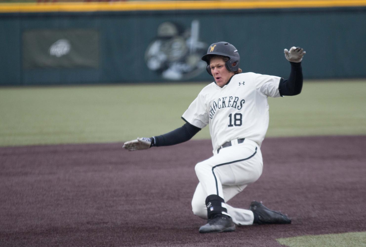 Wichita State third baseman Alec Bohm slides to third base during the game against Illinois State at Eck Stadium (April 29, 2017)