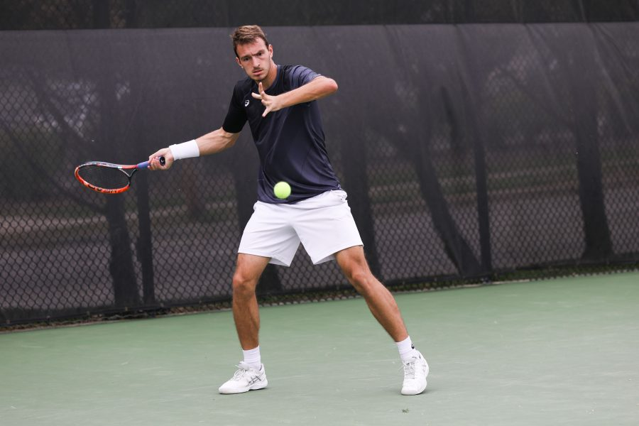 Wichita+State+player+Miroslav+Herzan+attempts+to+return+a+serve+during+Saturday%E2%80%99s+match+in+the+Coleman+Tennis+Complex.+%28Apr.+9%2C+2017%29