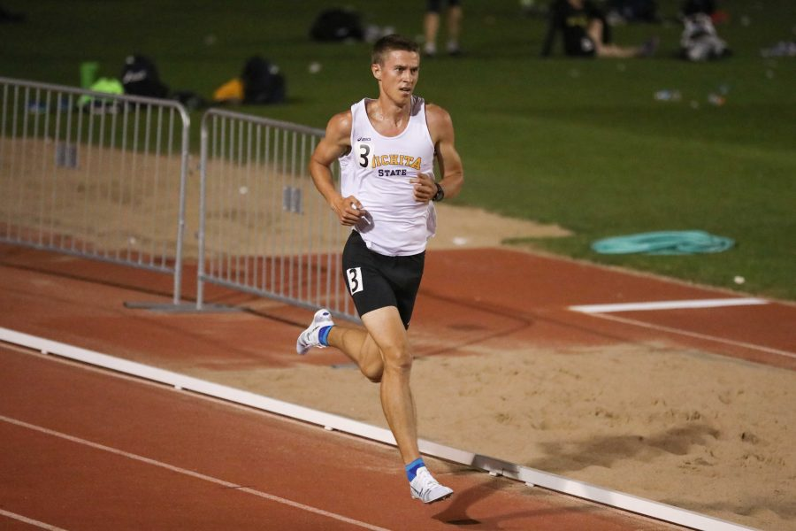 Senior+distance+runner+Ugis+Jocis+races+toward+the+finish+line+in+the+5%2C000+meter+run+at+the+KT+Woodman+Classic+on+Friday+night.+Jocis+won+the+race+and+claimed+his+U.S.+personal+record+with+a+time+of+14%3A35.55.+%28Apr.+14%2C+2017%29