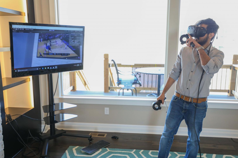 Wichita+State+graduate+student+Humam+Nameer+demonstrates+his+virtual+reality+program+he+created.