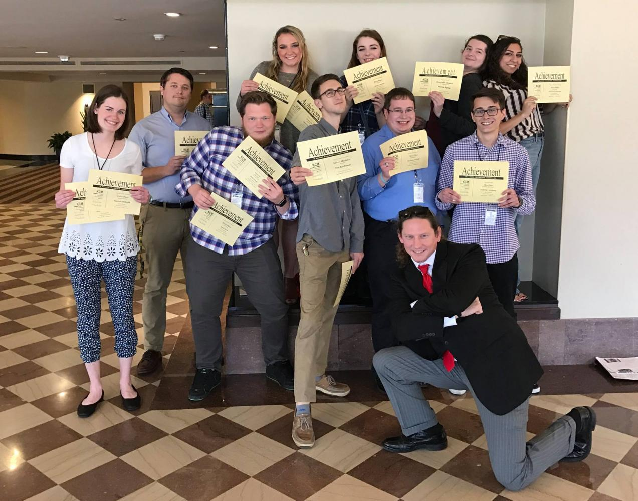 Members of The Sunflower staff pose with certificates earned at the Kansas Collegiate Media conference, held last month in Wichita. The staff collected 42 awards at the conference.