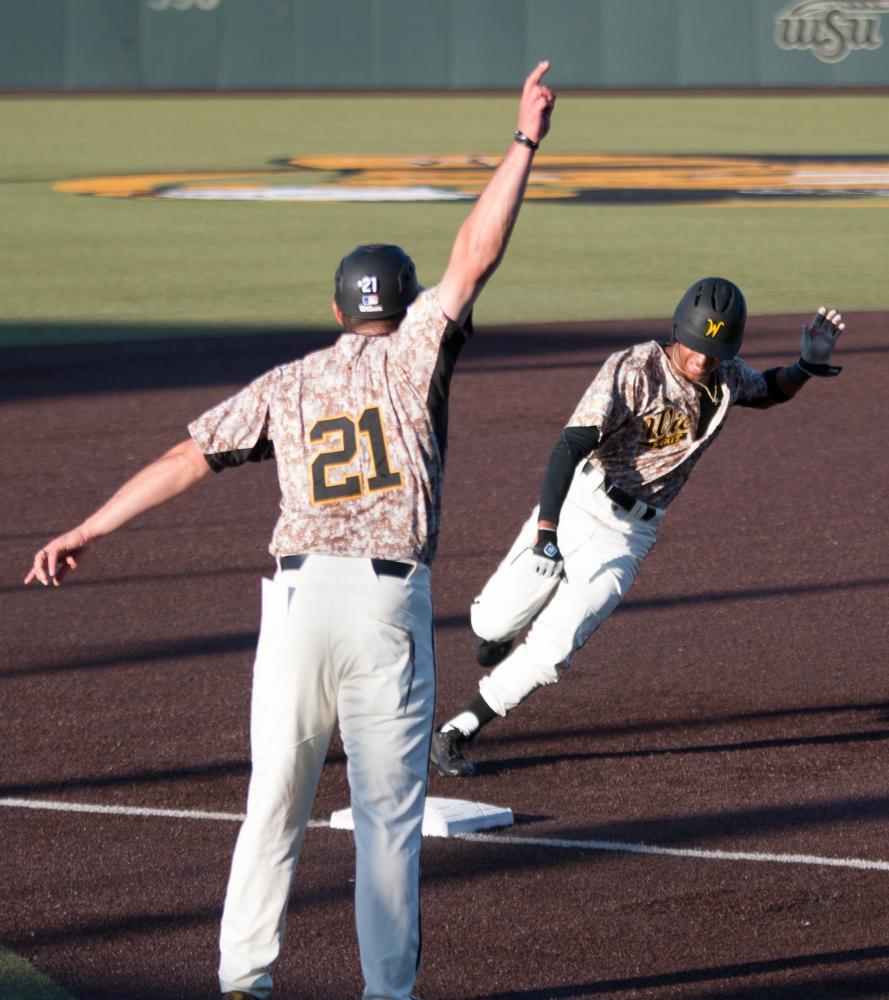 Wichita State freshman Alex Jackson rounds third base before scoring against Evansville at Eck Stadium Friday evening.