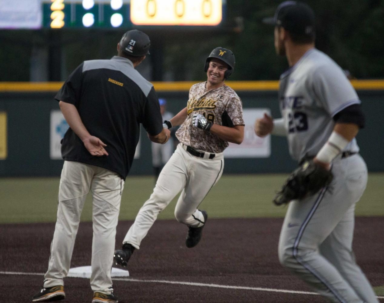Wichita+State+sophomore+Luke+Ritter+smiles+at+assistant+coach+Brian+Walker+after+hitting+a+walk-off+home+run+to+beat+K-State+3-2+Tuesday+evening+at+Eck+Stadium.