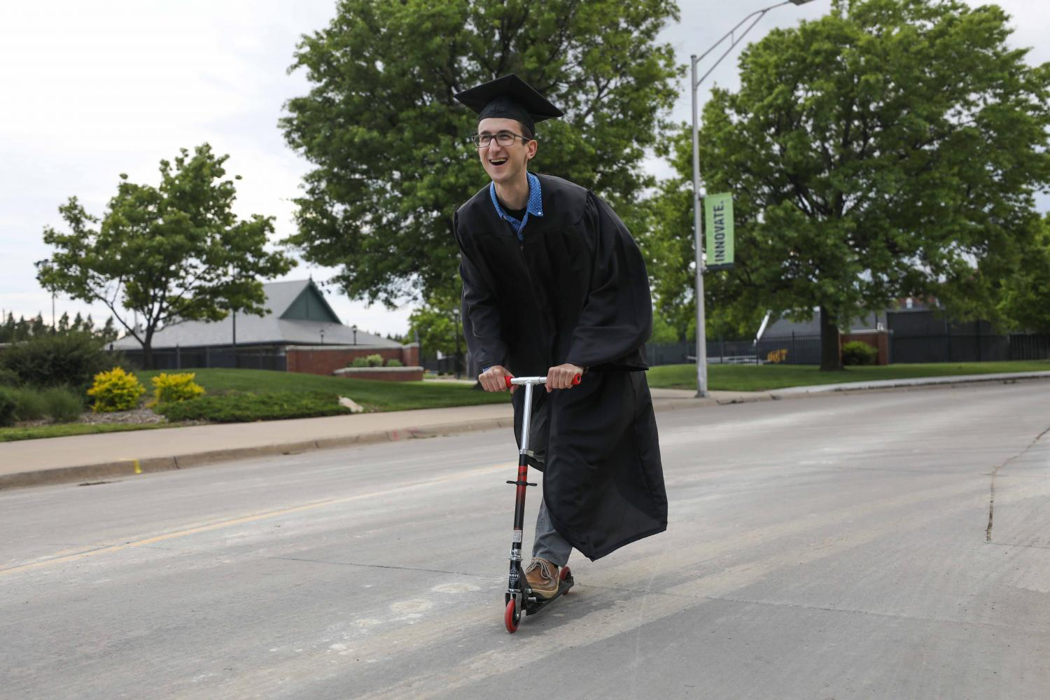 Wichita+State+student+Evan+Pflugradt+blissfully+scoots+his+way+into+graduation.%0APflugradt+bought+his+Star+Wars+themed+scooter+for+%247.50+at+a+Walmart.+