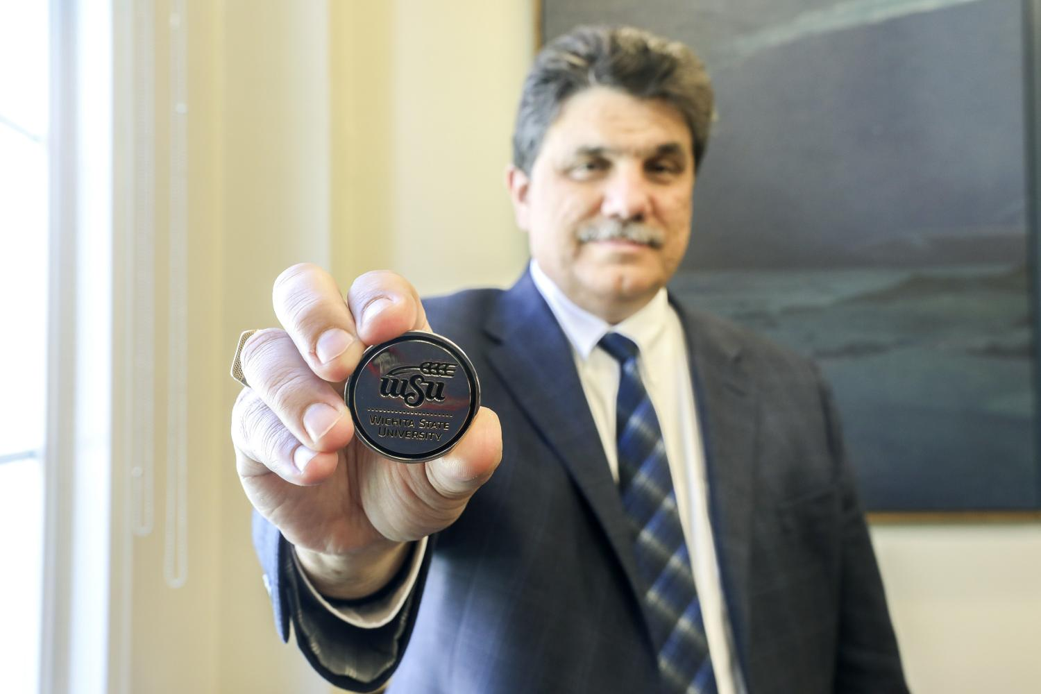 WSU+Provost+and+Senior+Vice+President+Anthony+Vizzini+holds+one+of+the+challenge+coins+given+to+graduates+during+the%0Aceremony.+Dr.+Vizzini+said+he+always+carries+one+in+his+pocket.