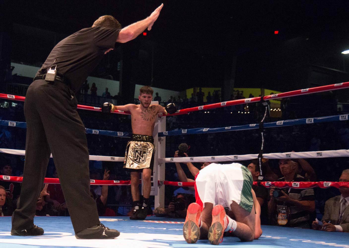 The referee counts off the seconds as Jose Rodriguez remains on the ground in the third round. Nico Hernandez won the Flyweight event by knockout at the KO Night Boxing held at Harman Arena in Park City. (June 17, 2017)