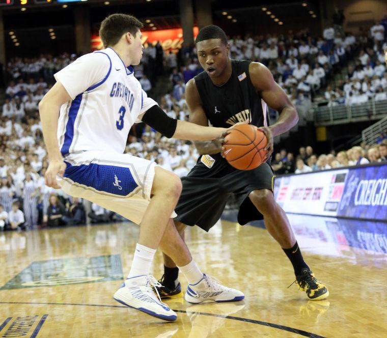 Wichita State's Cleanthony Early is defended by Creighton's Doug McDermott.
