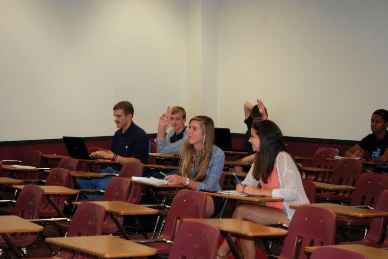 Student debaters receive coaching at the WSU debate camp.