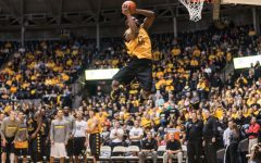 Kadeem Coleby excites the crowd during the Slam dunk competition during the Shocker Madness event which was held Friday Night at Koch Arena.