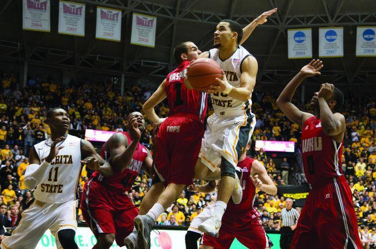 Fred+VanVleet+soars+towards+the+rim+in+Monday+nights+game+against+Western+Kentucky.+VanVleet+scored+17+points+in+the+game+to+help+the+Shockers+beat+the+Hilltoppers+66-49.