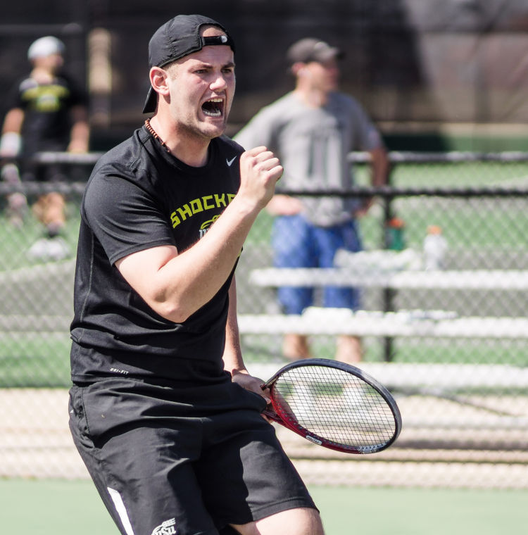 Senior+Ilija+Cuic+celebrates+with+a+fist+pump+Saturday+afternoon+inside+the+Sheldon+Coleman+Tennis+Complex+at+WSU%E2%80%99s+campus+during+his+doubles-match+with+teammate+Jocelyn+Devilliers.+They+won+their+doubles-match+8-7.