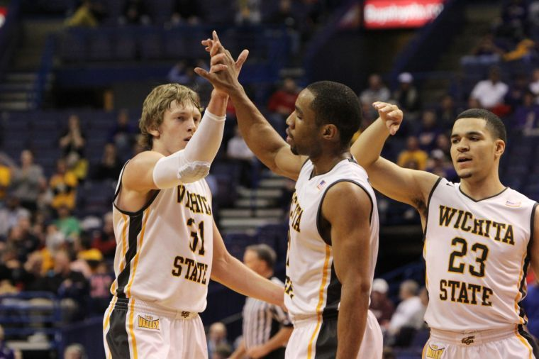 Ron Baker, Fred VanVleet and Tekele Cotton congratulate each other in Saturdays MVC Tournament victory over Evansville. The Shockers will celebrate their historic season on April 24 in Koch Arena.