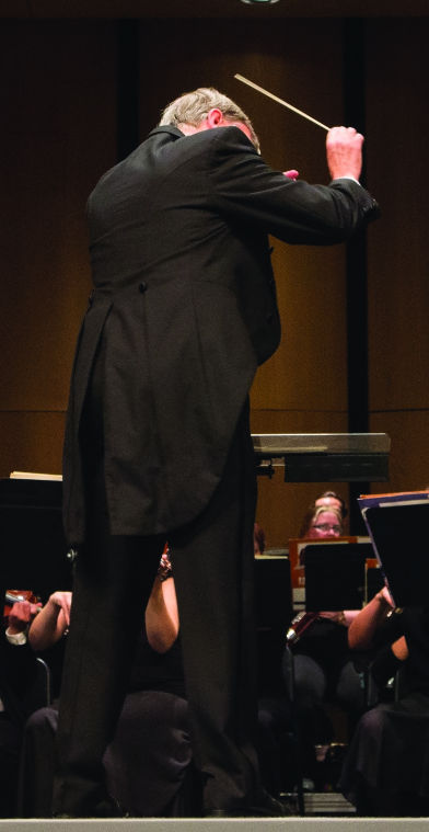 Mark Laycock, WSU Professor of Music, conducts the WSU Symphony Orchestra on July 18.