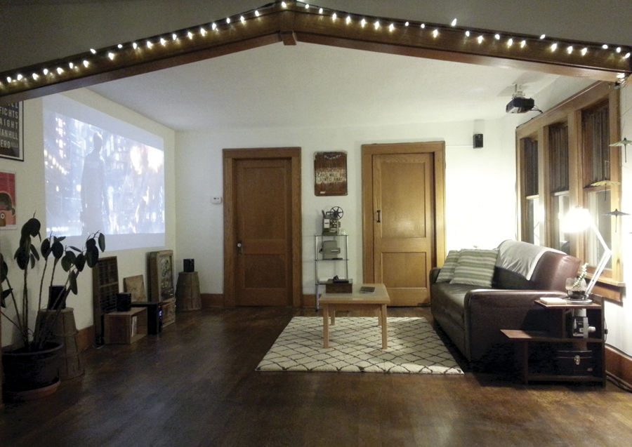 Although it takes research, time and energy to set up, mounting a projector to the ceiling and running the cords is an affordable and unobtrusive alternative to a television.