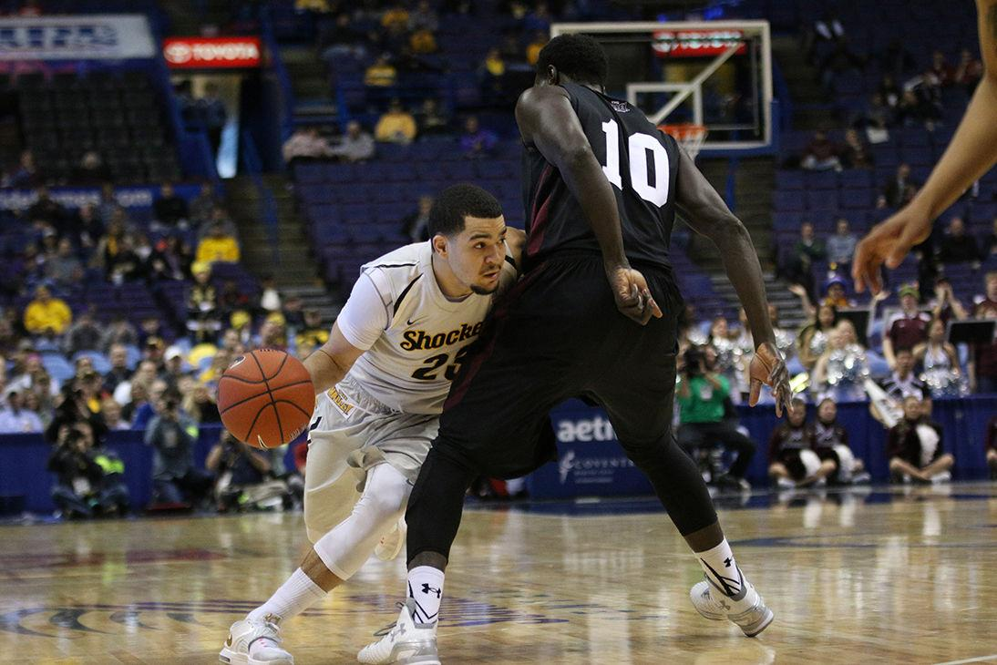 Fred VanVleet drives toward the basket against Ibby Djimde in the second half of Friday's game against Southern Illinois. The Shockers won 56-45 and advance to the semifinals of the Missouri Valley Conference tournament at the Scottrade Center in St. Louis, Mo.