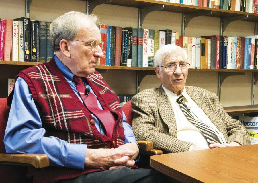 Wichita State political science professors Kenneth Ciboski and Melvin Kahn debate policy on Feb. 20